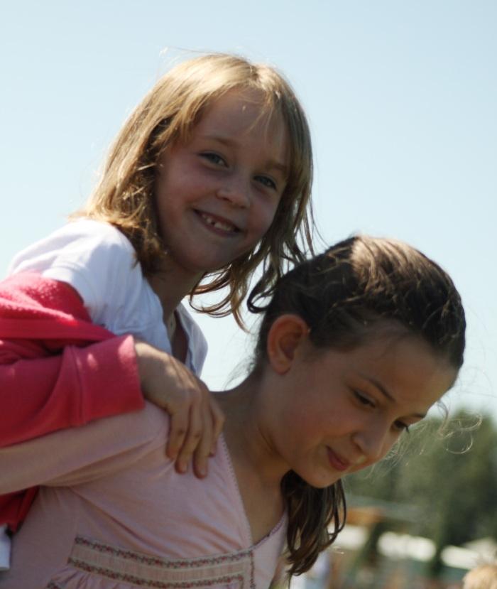 Erin giving her friend a piggy back ride